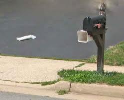 newspaper in driveway